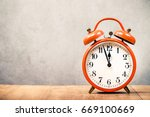 old retro orange alarm clock on ... | Shutterstock . vector #669100669