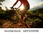 woman cyclist cycling on summer ... | Shutterstock . vector #669103048