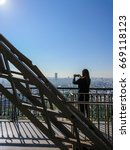 woman taking pictures of paris... | Shutterstock . vector #669118123