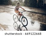 young boy riding bicycle in... | Shutterstock . vector #669122668