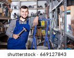 young worker with a tool in his ... | Shutterstock . vector #669127843