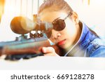 the woman at the shooting range ... | Shutterstock . vector #669128278