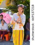 Small photo of CHIANGRAI -THAILAND NOVEMBER 21: Unidentified Tai Lue women (ethnic group living in parts Thailand) in Tribal dress show folk dance at on November 21, 2015 in Chiangrai,Thailand