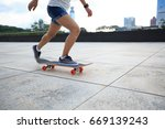 young woman skateboarder riding ... | Shutterstock . vector #669139243