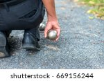 hand of holding steel ball.a... | Shutterstock . vector #669156244