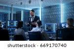 supervisor holds briefing for... | Shutterstock . vector #669170740
