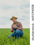 Small photo of Qualified agronomist explores wheat growth