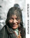 Small photo of Portrait of Tibetan Woman wearing Elaborate-Braids Hairstyle, Saga Dawa Festival, Mt.Kailash, Tarboche Valley, Tibetan Autonomous Region, China. May 30, 2007.