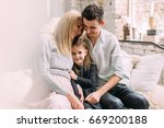 happy family of three people.... | Shutterstock . vector #669200188