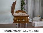 an open casket inside a funeral ... | Shutterstock . vector #669213583