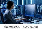 female system engineer controls ... | Shutterstock . vector #669226090