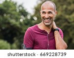 mature man listening to music... | Shutterstock . vector #669228739