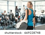 fit woman holding gym bag in a... | Shutterstock . vector #669228748