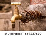 old brass water tap with chain... | Shutterstock . vector #669237610