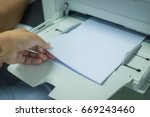 hand holding paper sheets into... | Shutterstock . vector #669243460