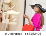 cheerful women with shopping... | Shutterstock . vector #669253408