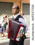 Small photo of SELARGIUS, ITALY - SEPTEMBER 8, 2013: Ancient Wedding  Selargino -  Accordionist musician who plays with a traditional Sardinian costume - Sardinia