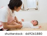 asian baby and mom | Shutterstock . vector #669261880