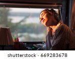 young woman enjoying morning... | Shutterstock . vector #669283678