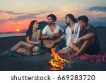 friends around the fire in... | Shutterstock . vector #669283720