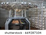 circular knitting machine | Shutterstock . vector #669287104