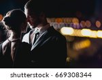 a couple in love stands against ...   Shutterstock . vector #669308344