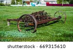 old iron plow used in the past... | Shutterstock . vector #669315610