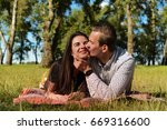 beautiful young couple lying on ...   Shutterstock . vector #669316600