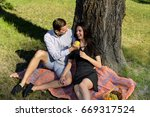 beautiful young couple sitting...   Shutterstock . vector #669317524