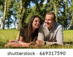 beautiful young couple lying on ...   Shutterstock . vector #669317590