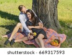 beautiful young couple sitting...   Shutterstock . vector #669317593