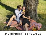 beautiful young couple sitting...   Shutterstock . vector #669317623