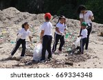 Small photo of May 5,2016, Dominican Republic,city Sosua, Charomikos district: little schoolchildren on excursion, near the ocean, learn to protect the environment - amicably remove garbage from the shore
