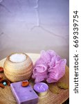Small photo of Home spa set - lavender handmade artisan soap, wisp of bast and bath salt. Copy space for text