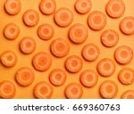 Sliced Carrot On Orange Color...