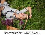 beautiful model girl in garden  ... | Shutterstock . vector #669376210