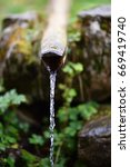 fresh water pouring from wooden ... | Shutterstock . vector #669419740
