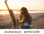young woman artist painting... | Shutterstock . vector #669421648