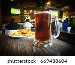 nachos and beer on a table of a ... | Shutterstock . vector #669438604