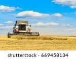 combine harvester is working in ...   Shutterstock . vector #669458134