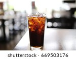 cola water with ice glass on... | Shutterstock . vector #669503176