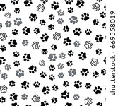paw print seamless. traces of... | Shutterstock .eps vector #669558019