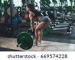 muscular young fitness woman... | Shutterstock . vector #669574228