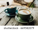 two cups cappuccino coffee... | Shutterstock . vector #669582079