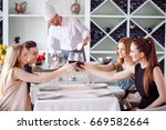 young people in a restaurant... | Shutterstock . vector #669582664