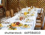 table setting food celebration... | Shutterstock . vector #669586810