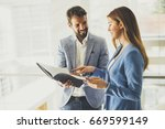 business partners analyze the... | Shutterstock . vector #669599149