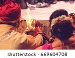 bride and groom hand   indian... | Shutterstock . vector #669604708