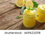 glass jars with yummy lemon... | Shutterstock . vector #669621058