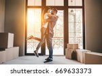 happy couple with cardboard... | Shutterstock . vector #669633373